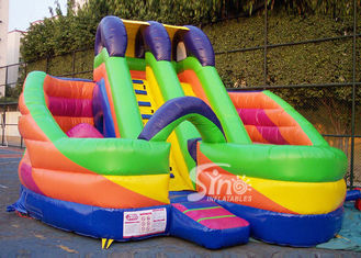 China 6x6m millenmium kids inflatable slide with obstacles N tunnel for outdoor parties supplier