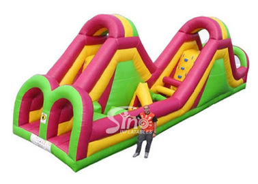 China 12m long giant commercial inflatable obstacle course with big slide for kids supplier