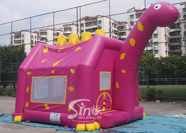 China Outdoor children playground Dino inflatable bouncy castle with obstacles inside made of 1st class pvc tarpaulin supplier