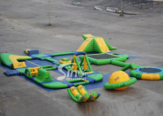 China 25x24 mts green N yellow giant inflatable water park for kids N adults with water trampoline, water seesaw N water spinn supplier