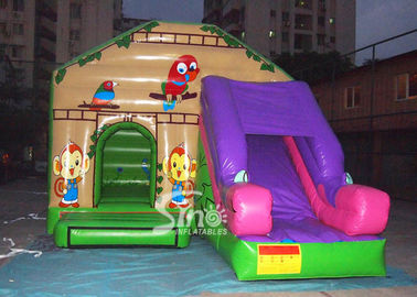 Commercial backyard jungle theme kids inflatable jumping castle with slide made of best pvc tarpaulin