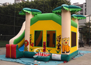 China Custom made outdoor tropical inflatable combo castle with slide made of lead free pvc tarpaulin supplier