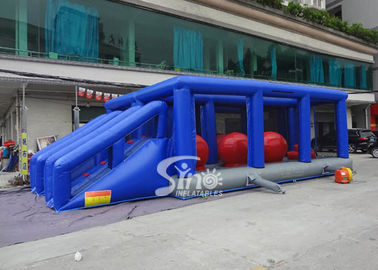 China Outdoor double lane adults interactive inflatable assault course with big bouncing balls supplier
