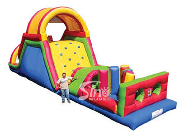 China Outdoor commercial rainbow kids inflatable obstacle course with big slide suitable for inflatable rentals supplier