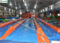 China 3 Lanes Orange Commercial Inflatable Water Slides Slip N Slide For City Adventure factory